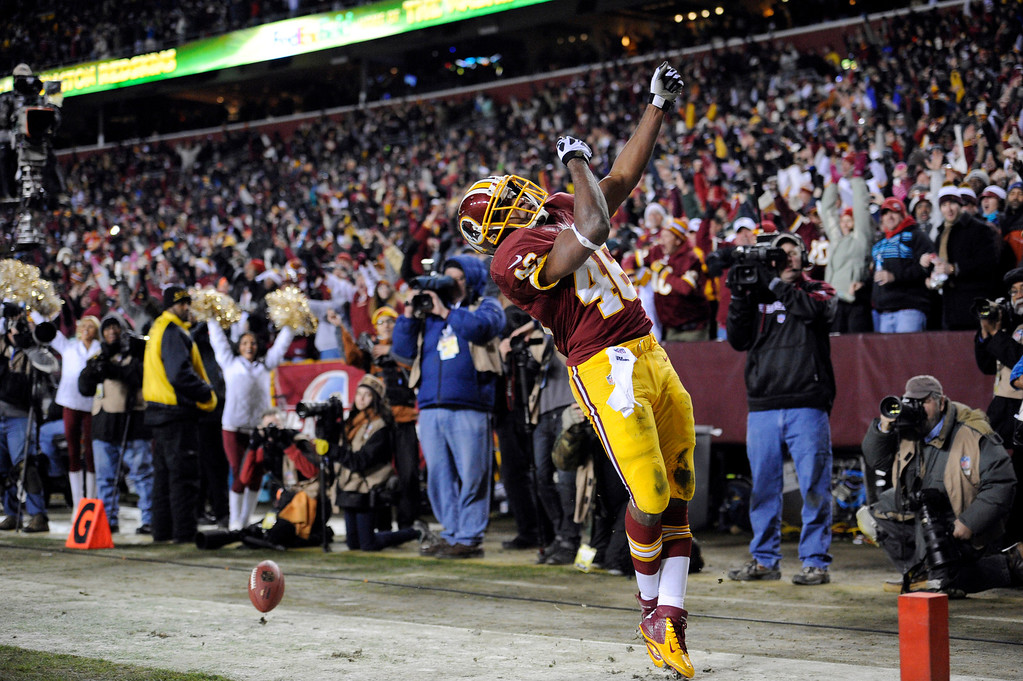. Washington Redskins running back Alfred Morris (46) celebrates his touchdown during the first half of an NFL football game against the Dallas Cowboys, Sunday, Dec. 30, 2012, in Landover, Md. (AP Photo/Nick Wass)