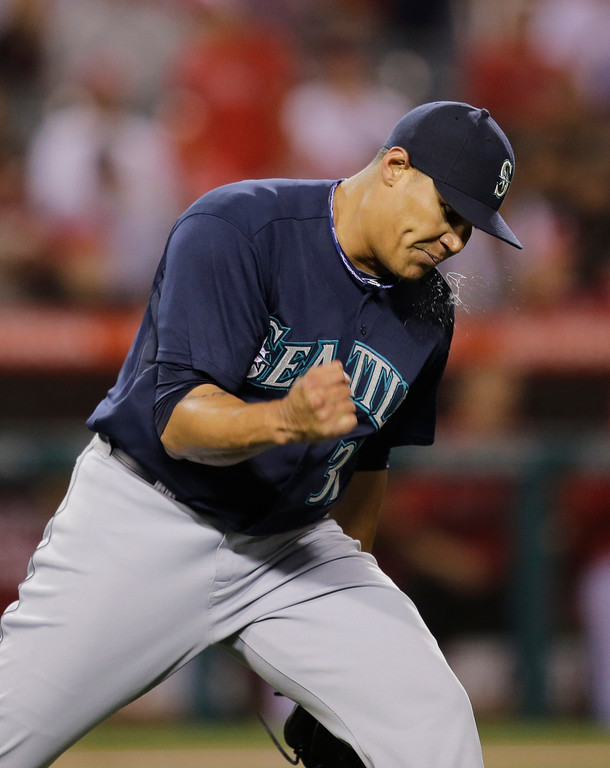 . Seattle Mariners relief pitcher Yoervis Medina pumps his fist as he gets the final out against the Los Angeles Angels during the 10th inning of a baseball game in Anaheim, Calif., Tuesday, June 18, 2013. The Mariners won 3-2. (AP Photo/Jae C. Hong)