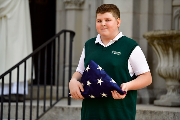 9/11/2019 Mike Orazzi | StaffrSt. Joseph School 8th grade student Brandon Benoit carries the American flag for the 9/11 ceremony in Bristol on Wednesday morning at St. Joseph Church.