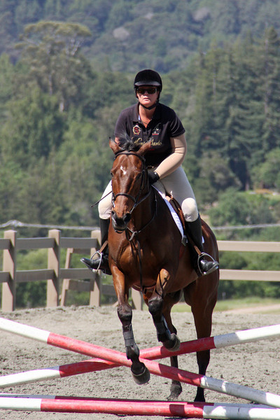 May 6: My sister Ann and her horse Star taking a practice jump before a competition