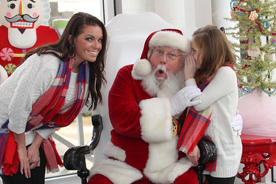 Keirstyn meets Santa at Sweet Pete's Candy Shop