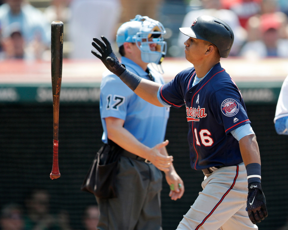 . Minnesota Twins\' Ehire Adrianza (16) tosses his bat after striking out in the sixth inning of a baseball game against the Cleveland Indians, Sunday, June 17, 2018, in Cleveland. (AP Photo/Tony Dejak)
