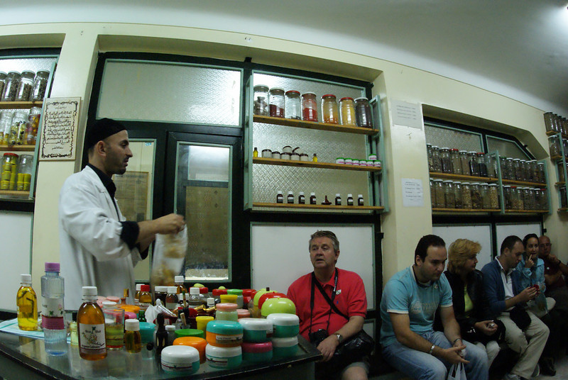 """Marrakesh, Morocco.  We got jammed into this little """"berberian pharmacy"""" to learn about traditional Moroccan cures.  Okay, it was interesting for about 5 minutes but we were stuck in here for an hour while the guy tried to sell us ever single thing he had.  Can you see the boredom on the people?"""