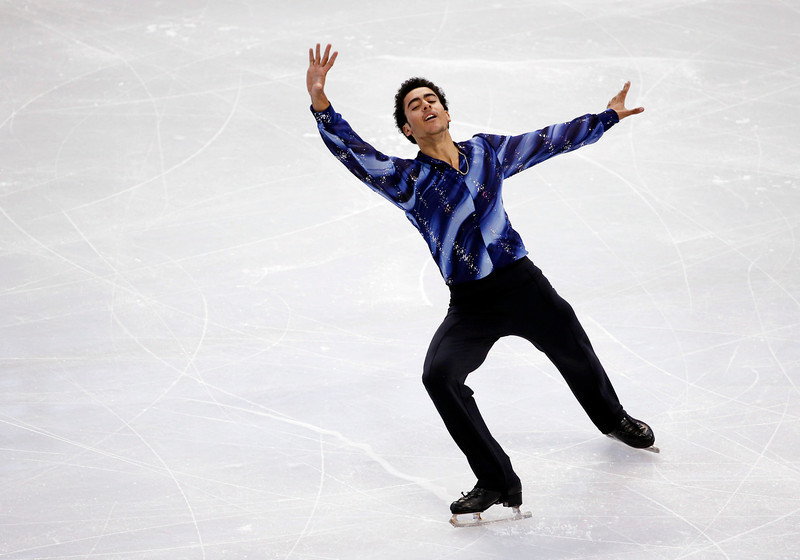 . Philip Warren competes in the men\'s free skate at the U.S. Figure Skating Championships in Boston, Sunday, Jan. 12, 2014. (AP Photo/Elise Amendola)