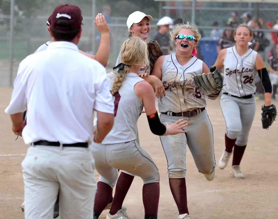 . Berthoud pitcher Sarah Jorissen is mobbed by teammates after recording a dramatic final out to beat Golden during the Berthoud Spartan Classic on Saturday Sept. 9, 2017 at the Barnes Complex. (Cris Tiller / Loveland Reporter-Herald)
