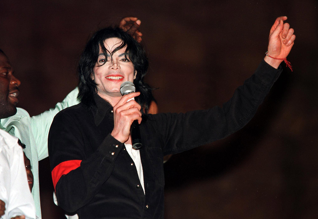 . Singer Michael Jackson performs at the Royal Towers grand opening gala at Atlantis Resort and Casino Dec. 12, 1998 on Paradise Island, Bahamas.  (AP Photo/Evan Agostini)