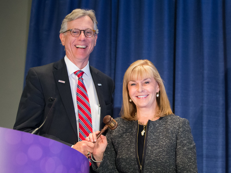 Dr. Julie M. Vose passes the gavel to Dr. Daniel Hayes during Annual Business Meeting