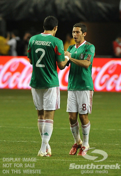 Mexico's Midfielder Israel Castro (#8) celebrates with Mexico's Defender Francisco Rodriguez (#2) after scoring a goal in Soccer action between Bosnia-Herzegovina and Mexico.  Mexico defeated Bosnia-Herzegovina 2-0 in the game at the Georgia Dome in Atlanta, GA.