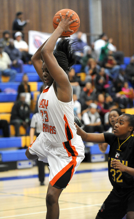 . McClymonds High\'s Breannie Robinson (23) grabs a key rebound against Oakland Tech High\'s Jayoni Lewis (32) in their Oakland Section high school girls basketball championship game played at Merritt College in Oakland, Calif. on Thursday, Feb. 28, 2013. (Dan Honda/Staff)
