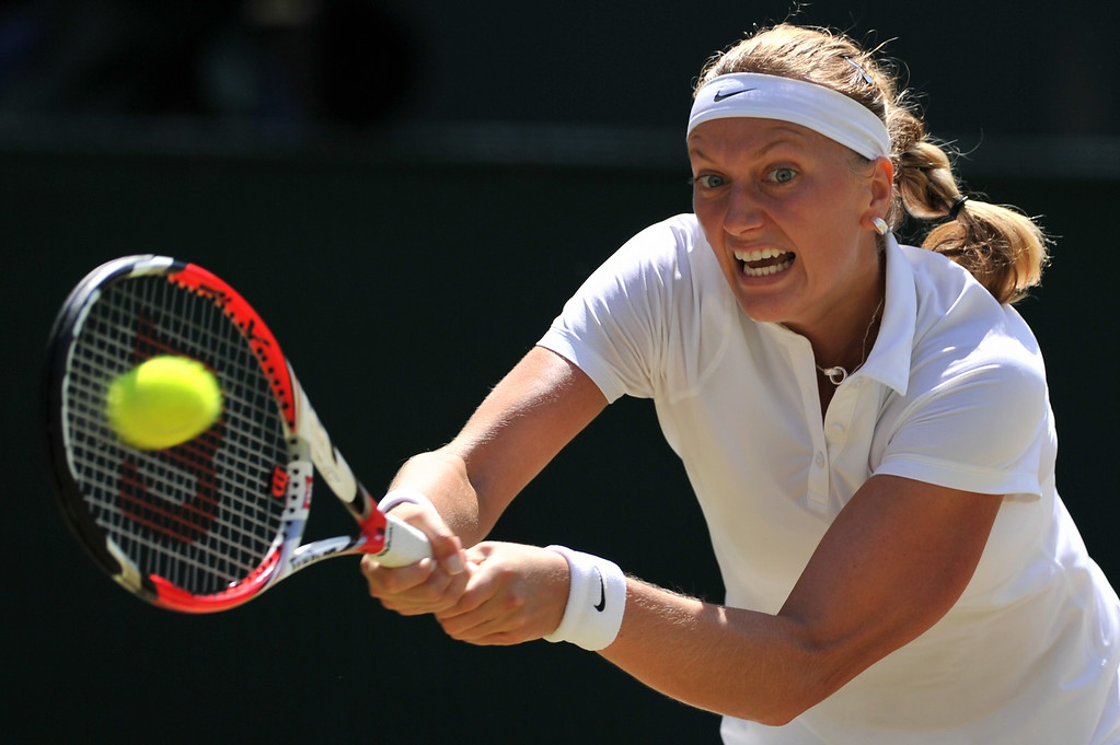 . Czech Republic\'s Petra Kvitova returns to Czech Republic\'s Lucie Safarova during their women\'s singles semi-final match on day ten of the 2014 Wimbledon Championships at The All England Tennis Club in Wimbledon, southwest London, on July 3, 2014.  GLYN KIRK/AFP/Getty Images