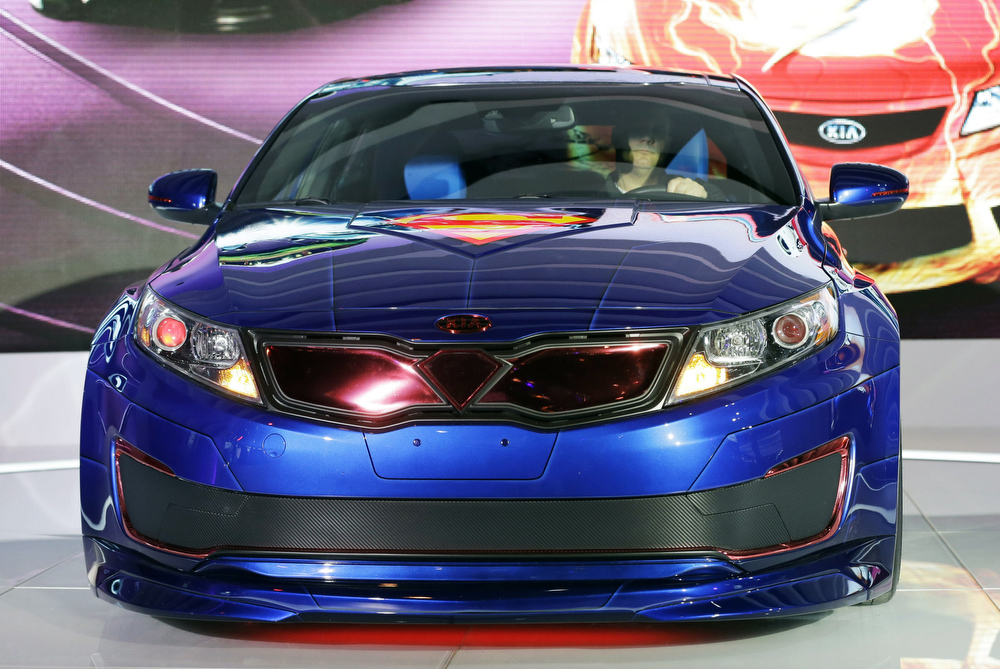 Description of . The Superman-Inspired Kia Optima Hybrid Soars is revealed during the media preview of the Chicago Auto Show at McCormick Place  in Chicago on Thursday, Feb. 7, 2013.e (AP photo/Nam Y. Huh)
