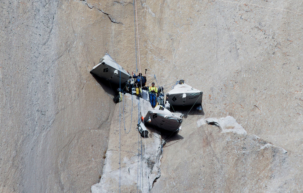 . In this Jan. 12, 2015 photo provided by Tom Evans, Tommy Caldwell, center, stands with a photographer at a base camp before continuing to climb what has been called the hardest rock climb in the world: a free climb of El Capitan, the largest monolith of granite in the world, a half-mile section of exposed granite in California\'s Yosemite National Park. El Capitan rises more than 3,000 feet above the Yosemite Valley floor. The first climber reached its summit in 1958, and there are roughly 100 routes up to the top. (AP Photo/Tom Evans, elcapreport)
