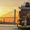 Tug escourting container ship out of the Port of Savannah