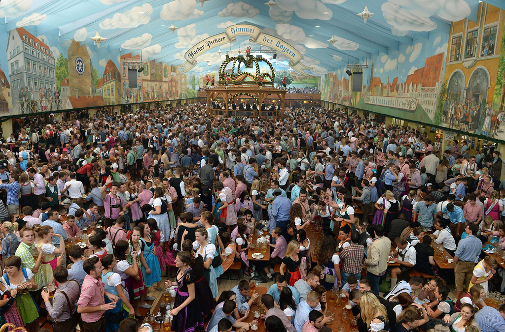 . People visit a festival tent during the Oktoberfest beer festival at the Theresienwiese in Munich, southern Germany, on September 21, 2013. The world\'s biggest beer festival Oktoberfest will run until October 6, 2013.  AFP PHOTO / CHRISTOF  STACHE/AFP/Getty Images