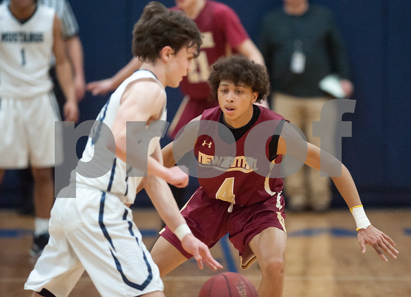 03/12/18 Wesley Bunnell | Staff New Britain basketball was eliminated from the Division II state tournament with a 56-41 loss to Immaculate in a game played at Immaculate on Monday night. Maurice Turner (4).