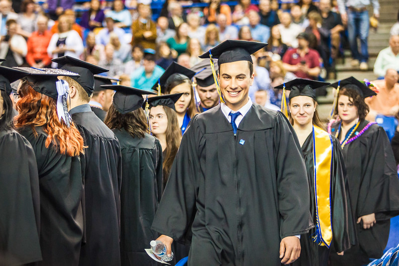 Ben Kirchenschlager is all smiles during the 2017 commencement ceremony processional Saturday, May 6, at the Carlson Center.