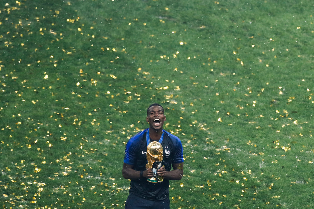 . France\'s Paul Pogba celebrates with the trophy at the end of the final match between France and Croatia at the 2018 soccer World Cup in the Luzhniki Stadium in Moscow, Russia, Sunday, July 15, 2018. (AP Photo/Rebecca Blackwell)