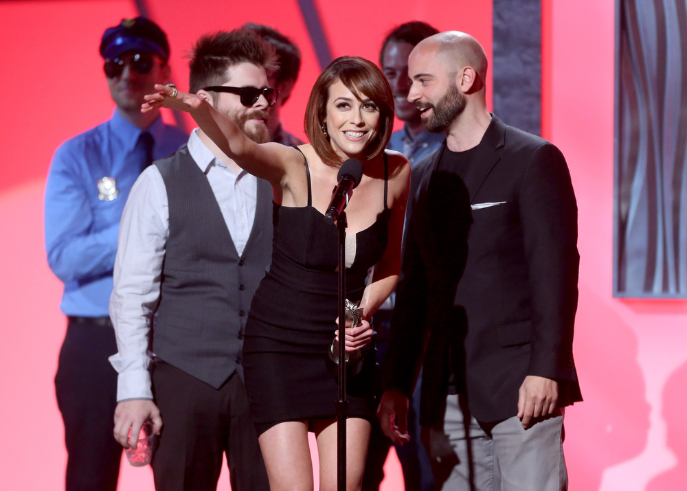 ". The cast of ""What\'s Trending\"" accepts the Best Live Series award onstage at the 3rd Annual Streamy Awards at Hollywood Palladium on February 17, 2013 in Hollywood, California.  (Photo by Frederick M. Brown/Getty Images)"