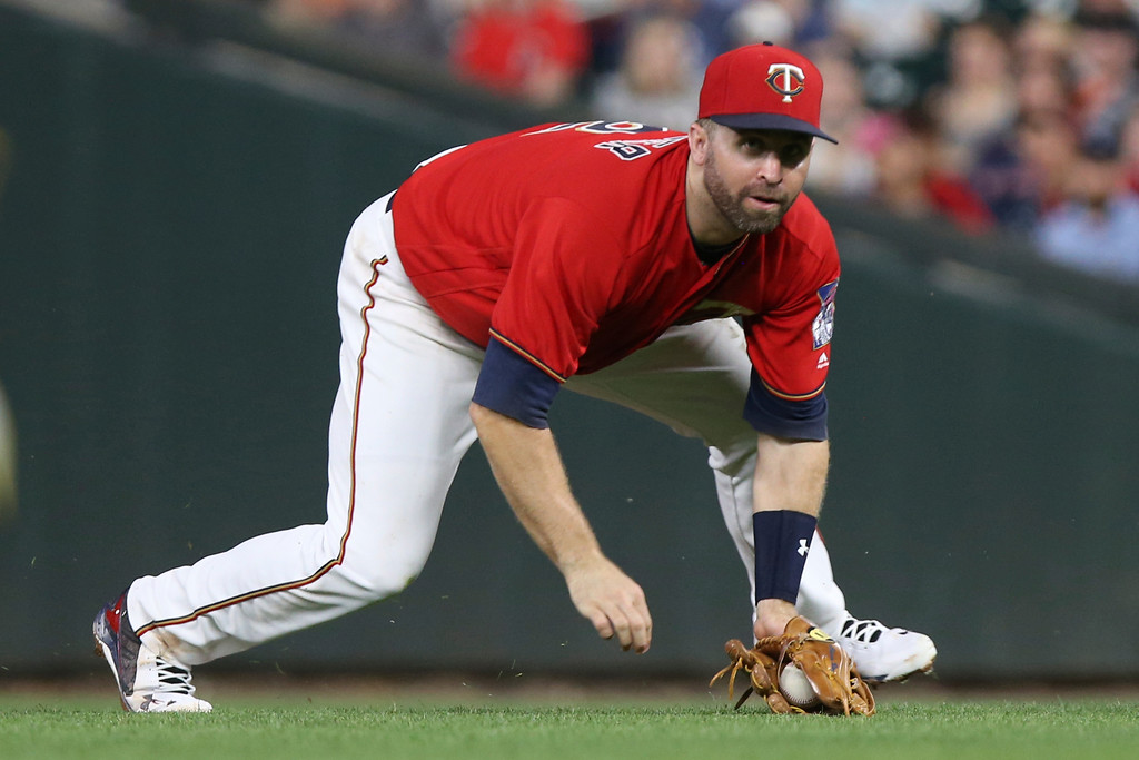 . Minnesota Twins\' Brian Dozier grabs a line drive by the Cleveland Indians in the sixth inning of a baseball game Monday, July 30, 2018 in Minneapolis. Minnesota won 5-4. (AP Photo/Stacy Bengs)