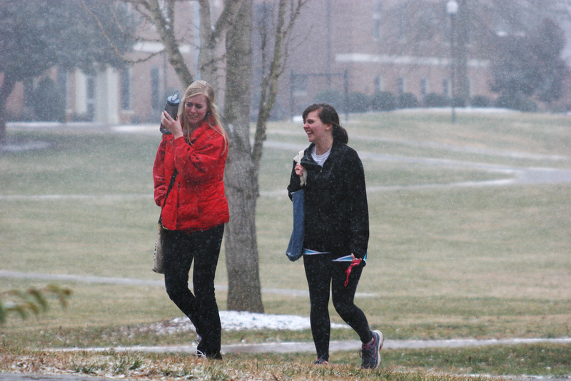 Some Gardner-Webb University students walking across campus during a light snow fall.