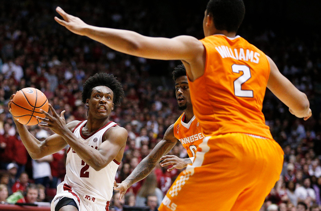 . Alabama guard Collin Sexton drives the ball to the basket against Tennessee guard Jordan Bone during the second half of an NCAA college basketball game on Saturday, Feb. 10, 2018, in Tuscaloosa, Ala. Alabama won 78-50. (AP Photo/Brynn Anderson)