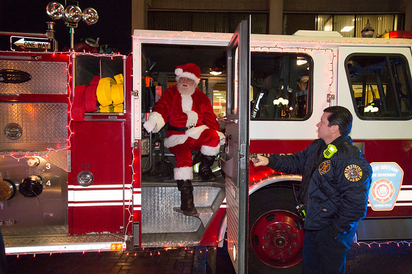 12/05/19 Wesley Bunnell | StaffrrThe New Britain Christmas tree was lit on Thursday night in Central Park complete with a visit from Santa Clause who rode in on a NBFD fire truck. Santa exits Engine 10 with help from firefighters.