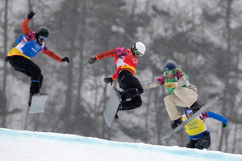 . (L-R) Regino Hernandez of Spain (blue bib), Lucas Eguibar of Spain (red bib), Alex Deibold of the United States (green bib) and Lluis Marin Tarroch of Andorra (yellow bib) compete in the Men\'s Snowboard Cross 1/8 Finals on day eleven of the 2014 Winter Olympics at Rosa Khutor Extreme Park on February 18, 2014 in Sochi, Russia.  (Photo by Adam Pretty/Getty Images)