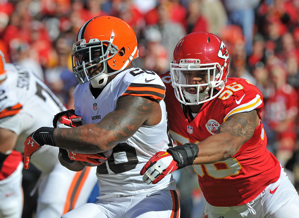 . Linebacker Derrick Johnson #56 of the Kansas City Chiefs tackles running back Willis McGahee #26 of the Cleveland Browns for a loss during the first half on October 27, 2013 at Arrowhead Stadium in Kansas City, Missouri. (Photo by Peter Aiken/Getty Images)