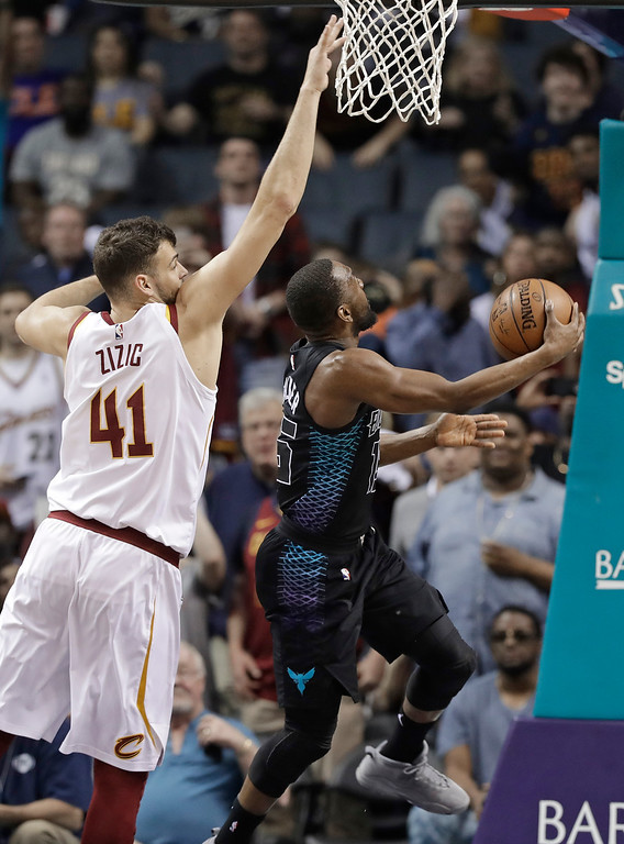 . Charlotte Hornets\' Kemba Walker (15) drives past Cleveland Cavaliers\' Ante Zizic (41) during the second half of an NBA basketball game in Charlotte, N.C., Wednesday, March 28, 2018. Walker passed former Hornet Dell Curry as the all-time scoring leader for the team with the basket. (AP Photo/Chuck Burton)