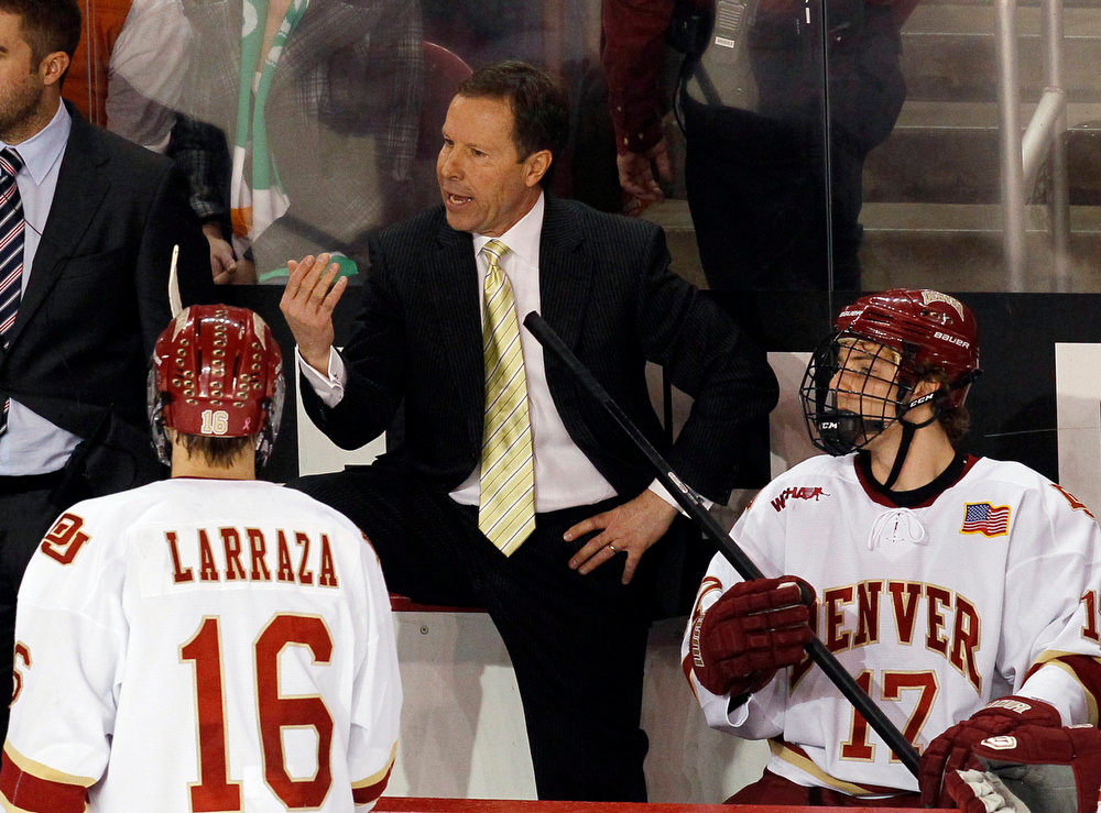 . Denver head coach George Gwozdecky, center, directs left wings Zac Larraza, left, and Garrett Allen during a timeout against Colorado College in the third period of Colorado College\'s 2-1 victory in Game 2 of a first-round college hockey playoff series in Denver, Saturday, March 16, 2013. (AP Photo/David Zalubowski)