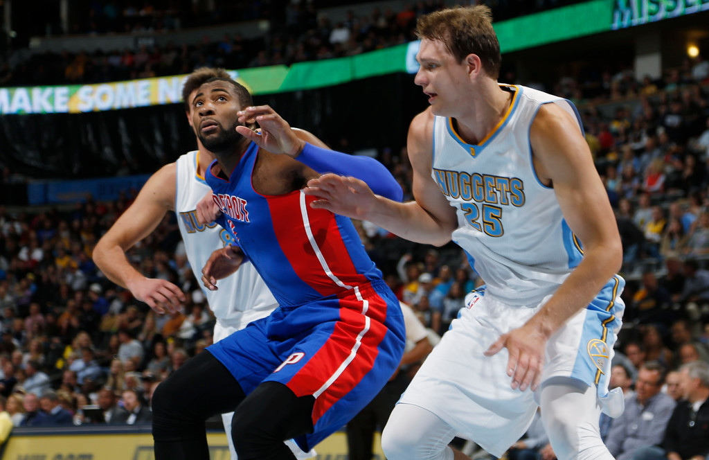 . Detroit Pistons center Andre Drummond, left, battles for position for rebound with Denver Nuggets center Timofey Mozgov, of Russia, in the first quarter of an NBA basketball game in Denver on Wednesday, Oct. 29, 2014. (AP Photo/David Zalubowski)