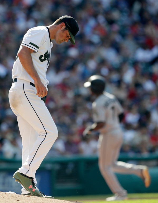 . Cleveland Indians starting pitcher Adam Plutko, left, waits for Chicago White Sox\'s Tim Anderson to run the bases after Anderson hit a solo home run in the fourth inning of a baseball game, Monday, May 28, 2018, in Cleveland. (AP Photo/Tony Dejak)