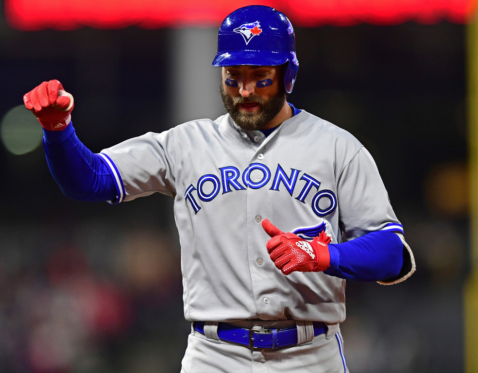 . Toronto Blue Jays\' Kevin Pillar celebrates after a RBI single in the fourth inning of a baseball game against the Cleveland Indians, Friday, April 13, 2018, in Cleveland. (AP Photo/David Dermer)