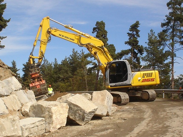 NPK DG-30 demolition grab on New Holland excavator - moving oversize rocks.JPG
