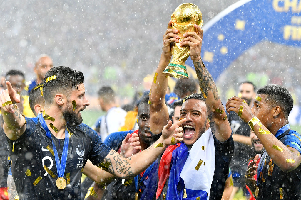 . France\'s Olivier Giroud, left, and France\'s Corentin Tolisso, center, celebrate after winning 4-2 in the final match between France and Croatia at the 2018 soccer World Cup in the Luzhniki Stadium in Moscow, Russia, Saturday, July 14, 2018. (AP Photo/Martin Meissner)