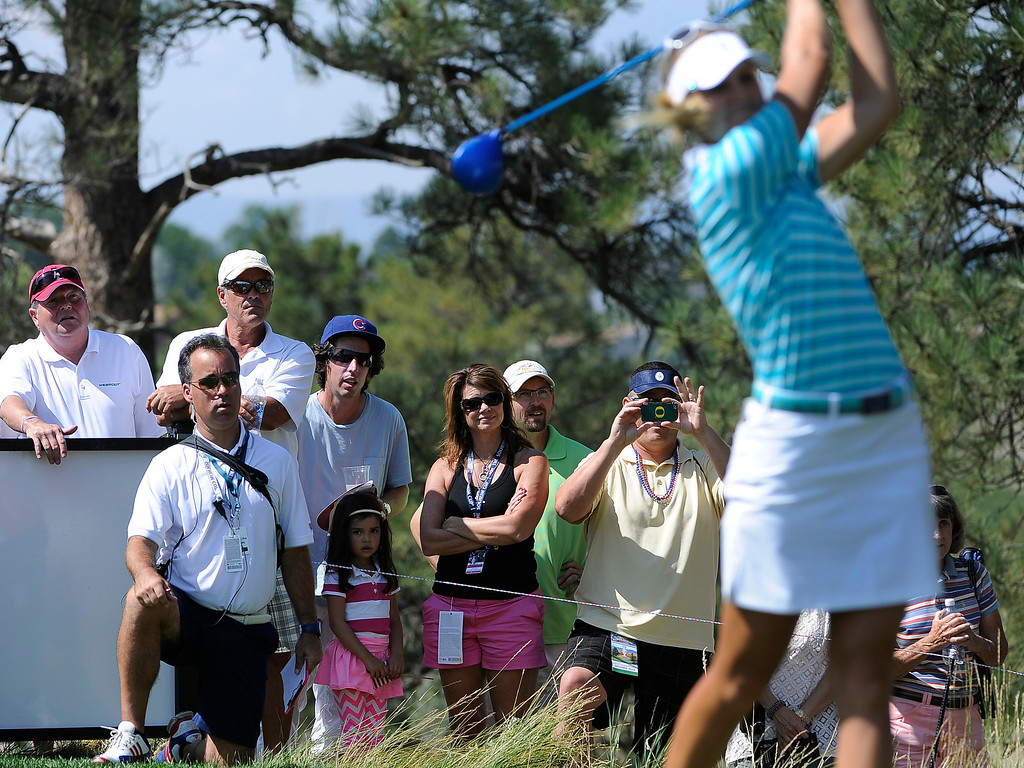 . PARKER, CO - Aug.17: Fans watch as team Europe\'s Anna Nordqvist tees off. The 2013 Solheim Cup takes place at the Colorado Golf Club with the USA taking on Europe in the Saturday morning Foursomes Match. (Photo By Kathryn Scott Osler/The Denver Post)