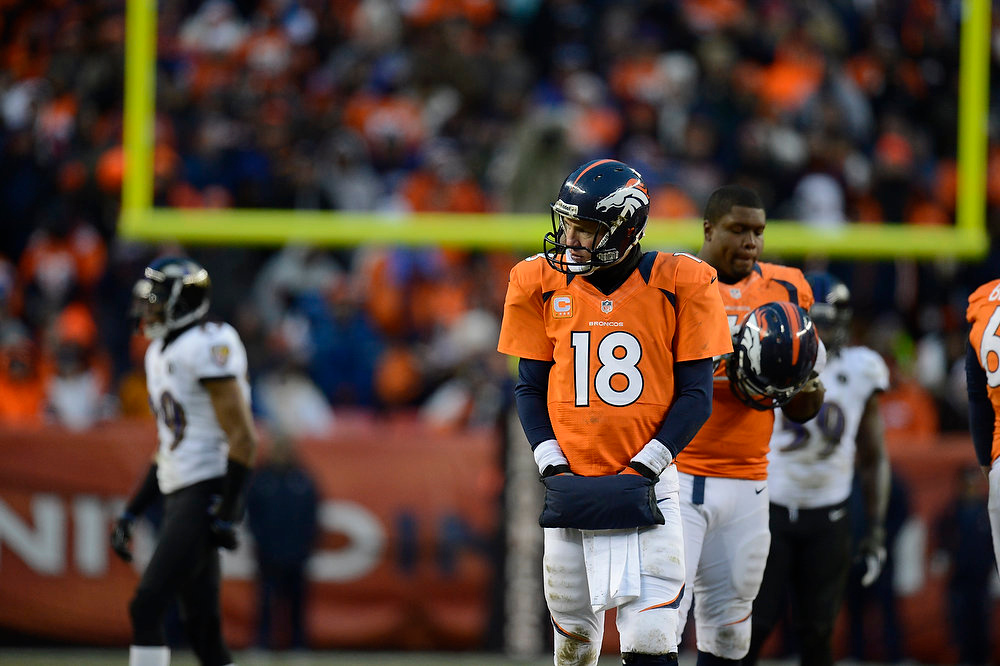. Denver Broncos quarterback Peyton Manning (18) waits for a referee call on the field in the third quarter. The Denver Broncos vs Baltimore Ravens AFC Divisional playoff game at Sports Authority Field Saturday January 12, 2013. (Photo by Joe Amon,/The Denver Post)