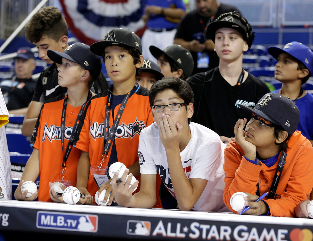 . Young fans wait for players to sign their baseballs, prior to the MLB baseball All-Star Game, Tuesday, July 11, 2017, in Miami. (AP Photo/Lynne Sladky)