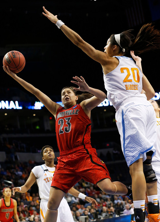 . Louisville guard Shoni Schimmel (23) shoots in front of Tennessee center Isabelle Harrison (20) in the second half of the regional final in the NCAA women\'s college basketball tournament in Oklahoma City, Tuesday, April 2, 2013. Louisville won 86-78. (AP Photo/Sue Ogrocki)