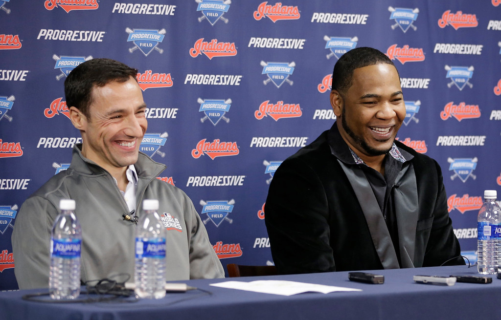 . Cleveland Indians president of baseball operations Chris Antonetti, left, and Edwin Encarnacion share a laugh during a news conference, Thursday, Jan. 5, 2017, in Cleveland. One win from a World Series title last season, the Indians finalized a $65 million, three-year contract with free agent slugger Encarnacion. (AP Photo/Tony Dejak)