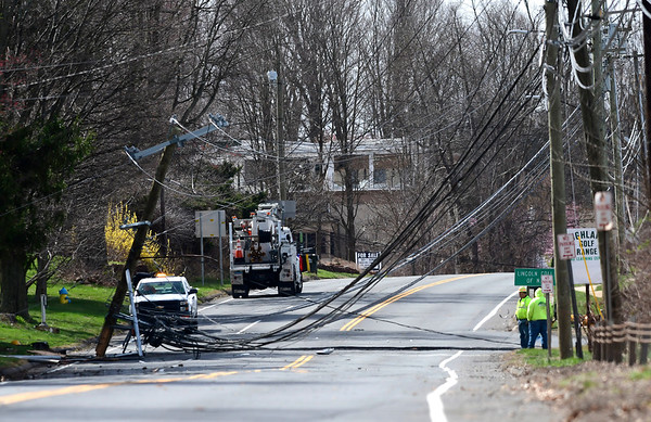 4/10/2020 Mike Orazzi | Staff An Eversource crew on scene of a crash on West Street in Southington on Friday morning after an early morning crash brought down a pole.