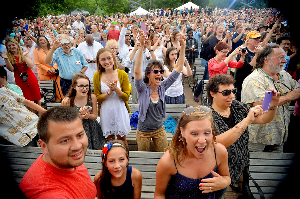 . The crowd reacts as President Barack Obama is introduced at the Lake Harriet Bandshell. Obama used the opportunity to address economic issues during the event.  (Pioneer Press: Ben Garvin)