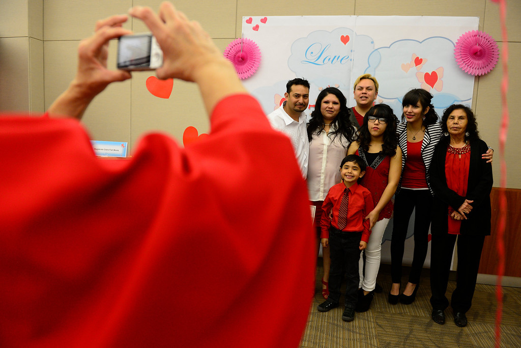 . DENVER, CO - FEBRUARY 14: Joel Herrera and Sylvenvestra Rodriguez pose with their family during a Valentine\'s Day marriage celebration at the Denver Clerk and Recorder\'s office. Couples applying for marriage licenses received gift bags containing gift certificates to local restaurants among other treats to celebrate their union. (Photo By AAron Ontiveroz/The Denver Post)