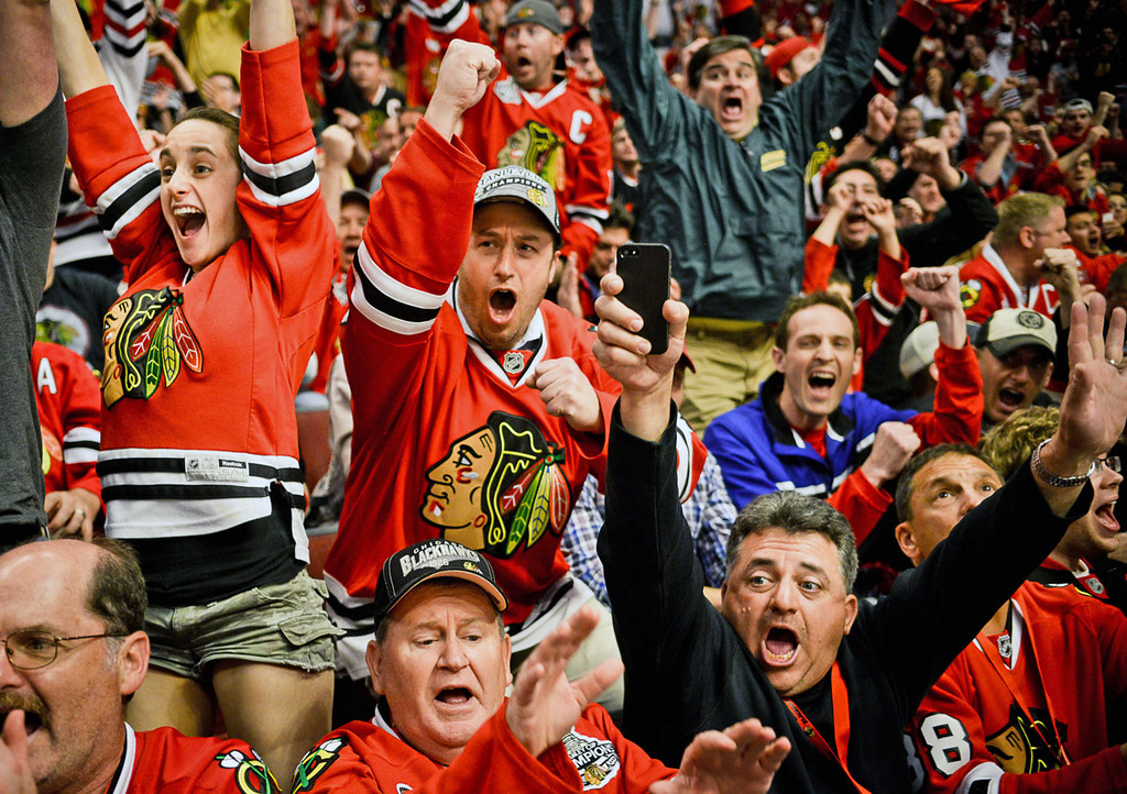 . Blackhawks fans react as their team scored their first goal against the Wild during the second period.  (Pioneer Press: Ben Garvin)