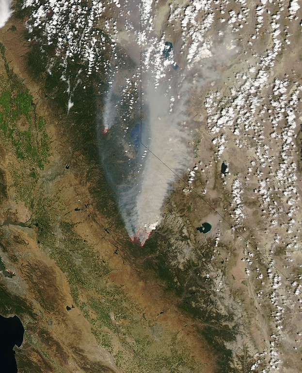 . This NASA Earth Observatory image obtained August 26, 2013 shows what  the Moderate Resolution Imaging Spectroradiometer (MODIS) on NASAs Aqua satellite acquired on August 22, 2013  in this image of the drought-fueled Rim fire burning in central California, near Yosemite National Park. Red outlines indicate hot spots where MODIS detected unusually warm surface temperatures associated with fires. Winds blew a thick smoke plume toward the northeast. A smaller fire American fire burned to the north. AFP PHOTO / NASA/Aqua-MODIS =HO/AFP/Getty Images