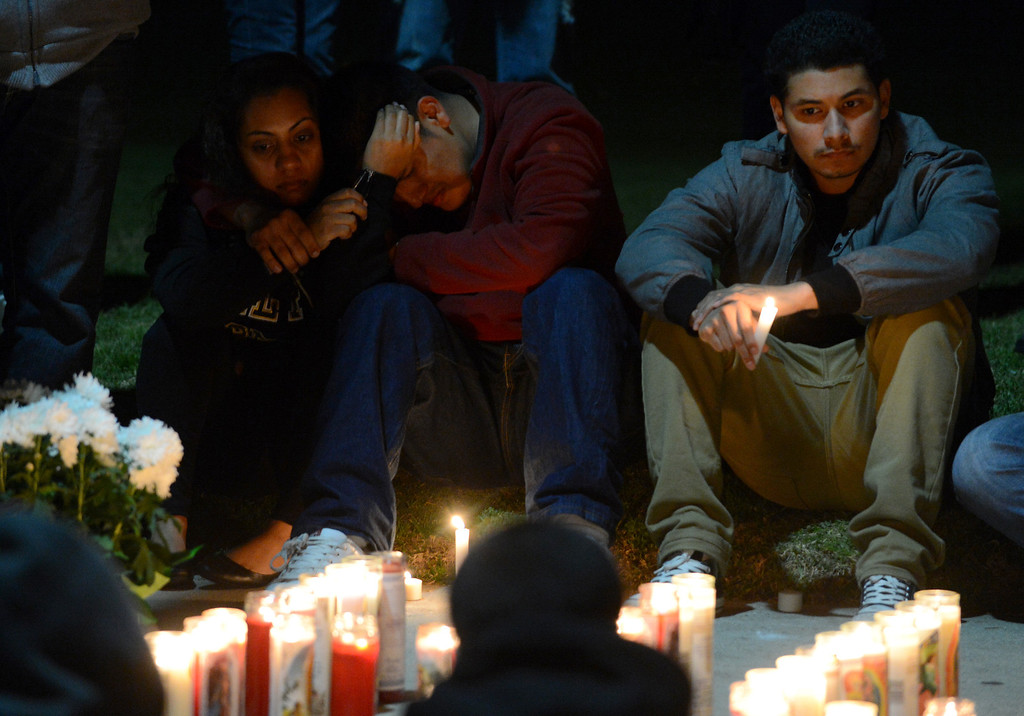 . Friends gather for a vigil to remember Ivan Arturo Aguilar Thursday, February 28, 2013, on Kellogg Drive at Cal Poly Pomona in Pomona. Aguilar, a 21-year-old communications student was struck and killed by a motorist on Kellogg Drive earlier in the day.  (Staff photo/Inland Valley Daily Bulletin)