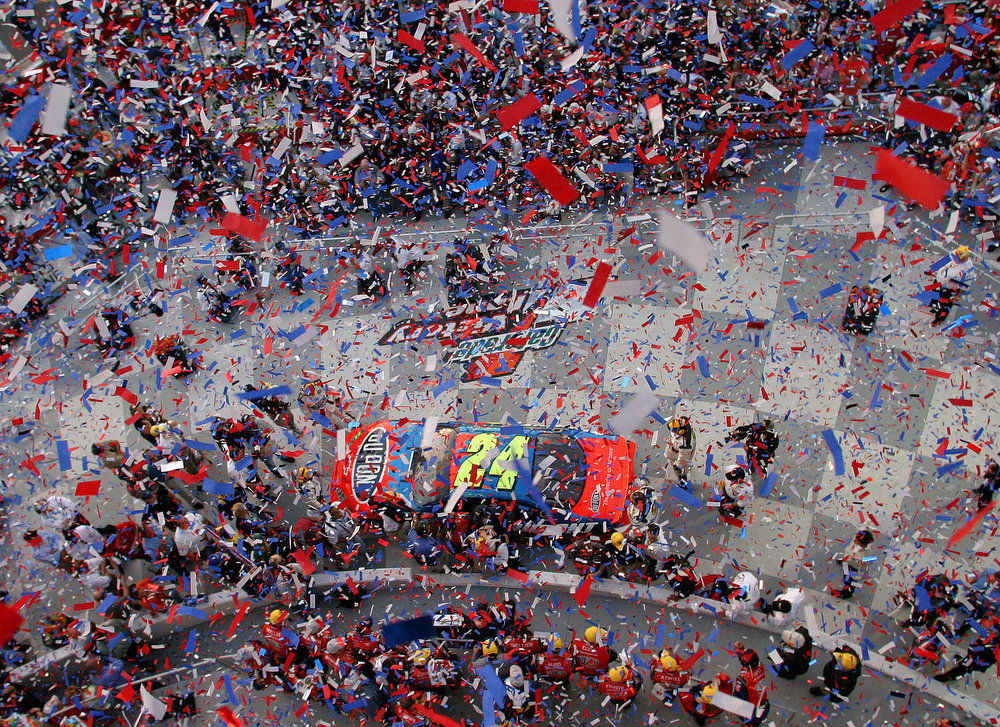 Description of . NASCAR driver Jeff Gordon and his crew celebrate in Victory Lane following his win in the Daytona 500 at the Daytona International Speedway in Daytona Beach, Fla., on Sunday, Feb. 20, 2005. (AP Photo/Bob Jordan)