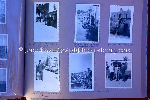 MADAGASCAR, Antananarivo, Ambohitrarahaba. Beit HaTefilah Israel, Photographs of Georges Rakotomisa (deceased grandfather of community members) in Israel, 1961, who went to learn about kibbutzim to establish in Madagascar (8.2014)