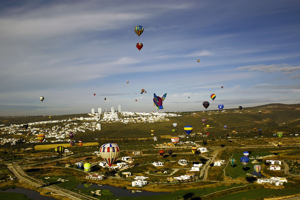 . Hot air balloons fly over the Metropolitan Park in Leon City, Guanajuato State, Mexico, during the International Balloon Festival on November  15, 2013.   AFP PHOTO/Hector GUERRERO/AFP/Getty Images