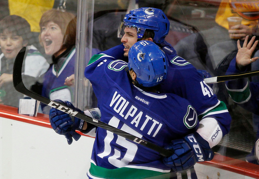. Vancouver Canucks\' Maxim Lapierre celebrates his goal against the Colorado Avalanche with teammate Aaron Volpatti during the second period of their NHL hockey game in Vancouver, British Columbia January 30, 2013.   REUTERS/Ben Nelms